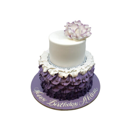 purple & white cake with flower